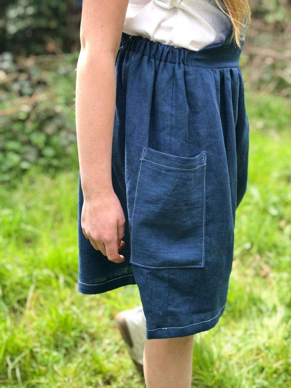 robe tablier lin bleu sarcelle poches plaquées